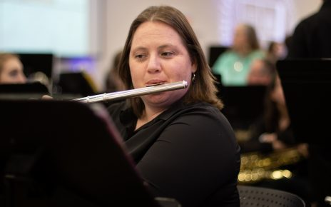Student Playing Flute (Image Credit: Eli Hark)